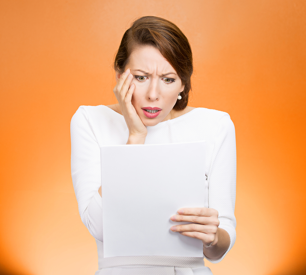 Frustrated woman with taxes