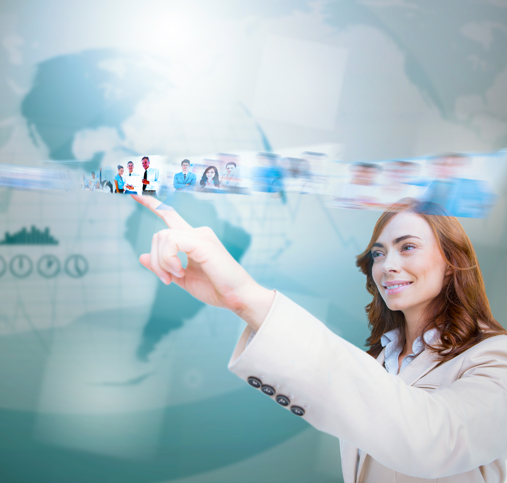 Smiling businesswoman scrolling pictures on blue map background